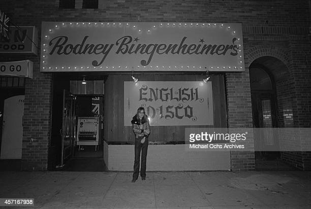 Nightclub owner Rodney Bingenheimer stands outside his English Disco located at 7561 Sunset Boulevard on the Sunset Strip circa 1974 in Los Angeles...