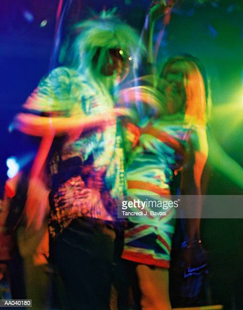 nightclub, uk, woman in union jack dress - bavosi stock pictures, royalty-free photos & images