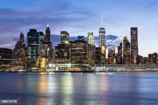 nightfall over manhattan financial district in new york, usa - new york skyline stock photos and pictures
