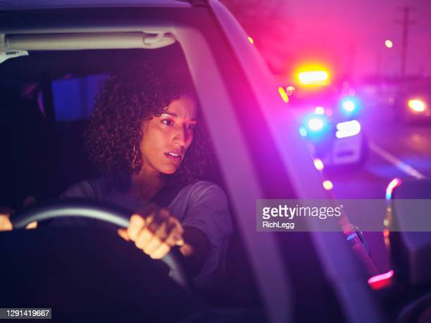 nightime police traffic stop - traffic examining stock pictures, royalty-free photos & images