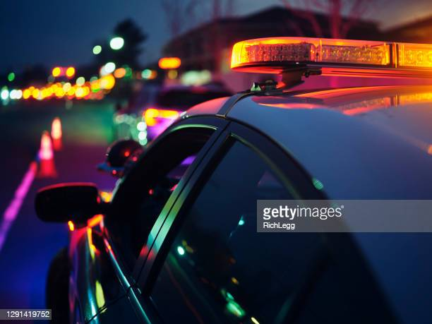 nightime police traffic stop - officer stock pictures, royalty-free photos & images