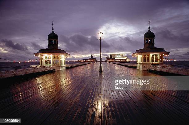A nightime view of refelctions and illuminations on a rainy Blackpool Pier November 1970