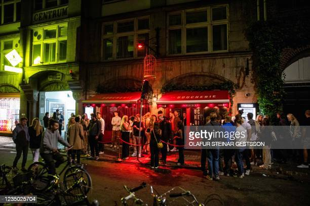"""Nightlife guests stand in front of the """"La Boucherie"""" cocktail-nightclub on Vestergade street in Copenhagen during the night between September 2 and..."""