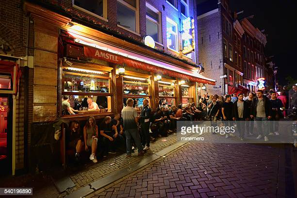 nightlife in amstedam - red light district stock photos and pictures