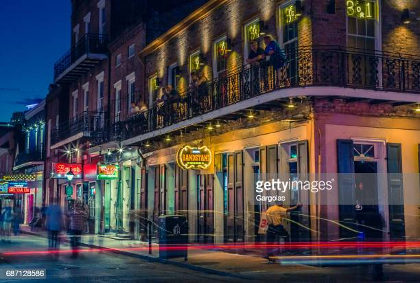 nightlife in the french quarter of new orleans, louisiana - mardi gras fun in new orleans stock photos and pictures
