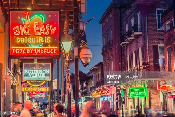 nightlife in the french quarter of new orleans, louisiana - mardi gras party stock photos and pictures