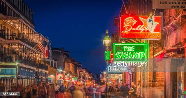 nightlife in the french quarter of new orleans, louisiana - mardi gras flashing stock photos and pictures