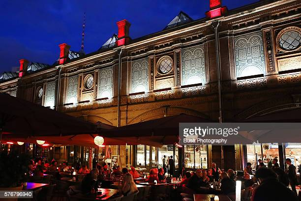 Nightlife, sidewalk cafes and bars at Hackescher Markt S-Bahn Station, in the historical district of Berlin Mitte, Germany