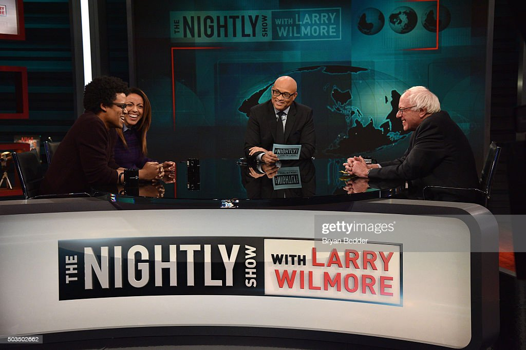 'Nightly Show' contributors Jordan Carlos, Grace Parra, Host Larry Wilmore and Senator Bernie Sanders speak on 'The Nightly Show With Larry Wilmore' on January 5, 2016 in New York City.