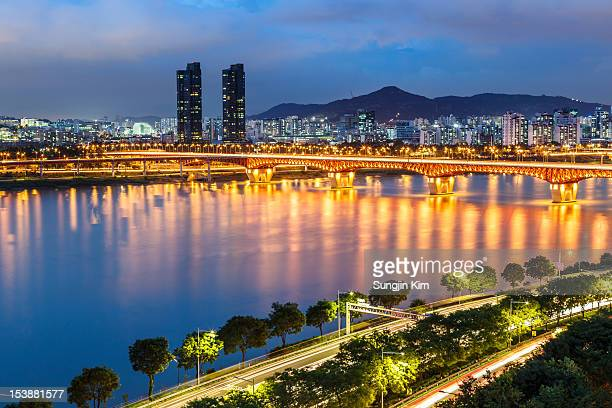 nightscape of city with lighting on the bridge - sungjin kim stock pictures, royalty-free photos & images
