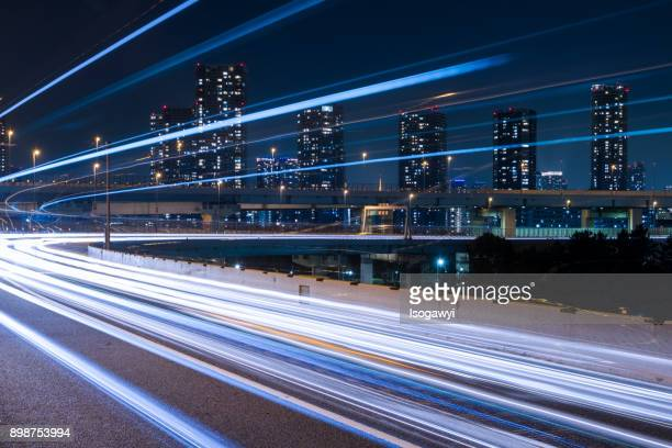 nightscape of highway at tokyo city - long exposure stock pictures, royalty-free photos & images