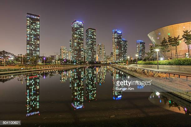 nightscape of songdo with skyscraper - songdo ibd stock pictures, royalty-free photos & images