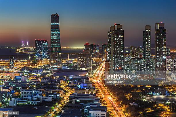 nightscape of songdo with skyscrapers - songdo ibd stock pictures, royalty-free photos & images