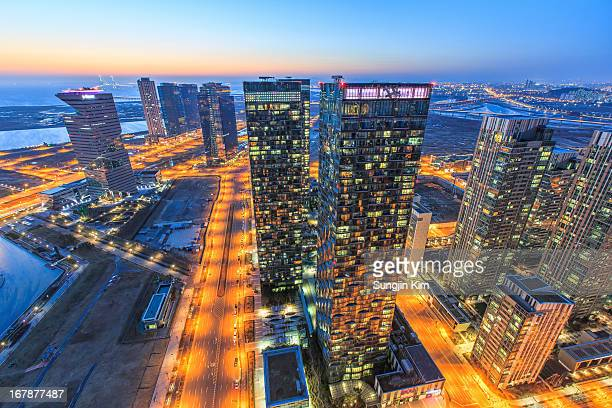 nightscape of the city - songdo ibd stock pictures, royalty-free photos & images