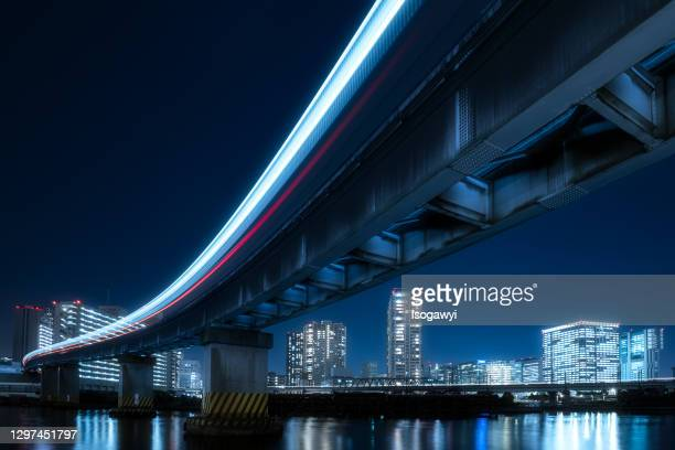 nightscape of tokyo city under monorail light trails - isogawyi stock pictures, royalty-free photos & images