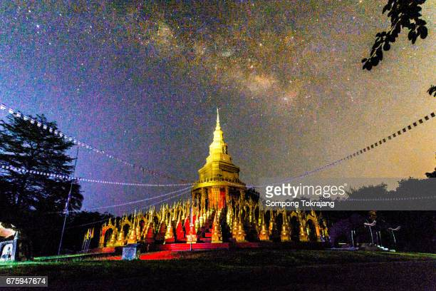 Nightscapes at temple thailand.Milky Way galaxy, Long exposure photograph, with grain.Image contain certain grain or noise and soft focus.