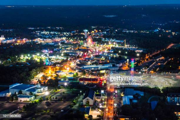 nighttime aerial view of hwy 76, branson missouri - 1011957648,1011945618,1011950492,1011960800,1011954950,1011953954,1015768380,1015768366,1015768370,1015768372,1015768382,1015768398,1015768412,1015768410,1015768414,1015768418,1015768438,1015768448,1015768450,1015768488,1015768474,1015768478,1015768504,1015768508,1016083590,1016083634,1016083592,1016083608,1016083686,1016083708,1016083780,1016083774,1016083796,1016083828,1016083994,1016083992,1016083982,1016083980 stock pictures, royalty-free photos & images
