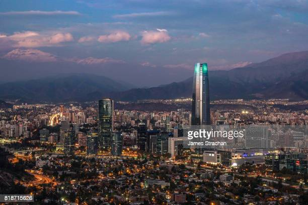 night-time aerial view of the city including the torre santiago (tallest building in south america, 300m), from cerro san cristobal of santiago, chile - santiago chile fotografías e imágenes de stock