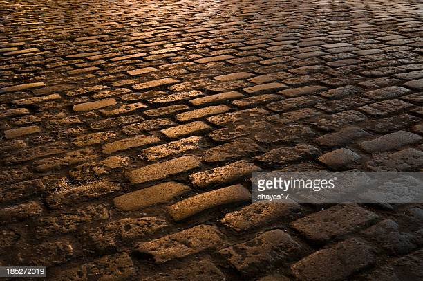 nighttime cobblestone street - soho new york stock photos and pictures