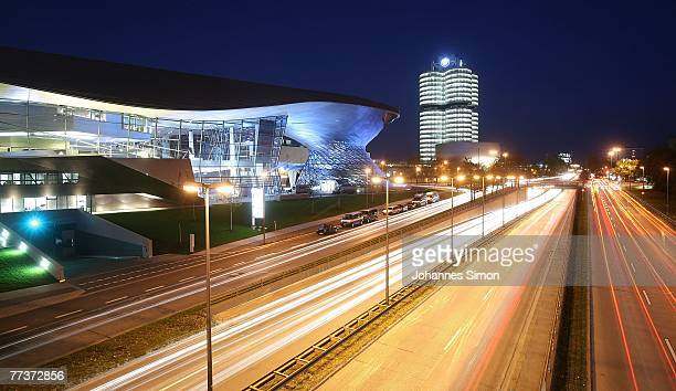 Nighttime exterior view of the BMW World and BMW tower seen after the BMW World's opening ceremony on October 17 2007 in Munich Germany BMW World is...