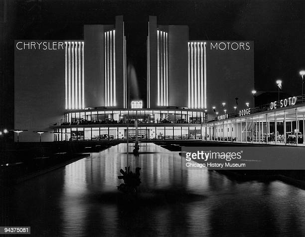 Nighttime illuminated view of the Chrysler Motors building taken during the Chicago World's Fair or the Century of Progress International Exposition...