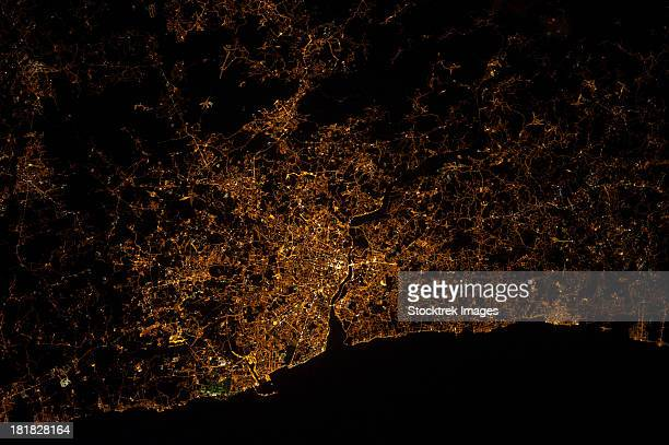 Nighttime image of Portugal showing city lights of Porto and Vila de Gaia.
