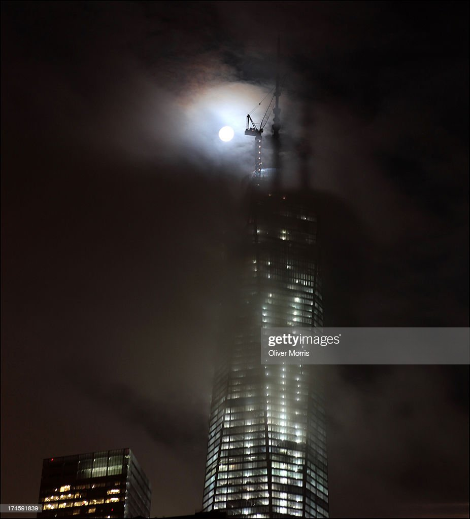 A nighttime, moon-lit view (as seen looking south from Hudson River Park) of the 450 foot spire and construction crane on top of the under-construction Freedom Tower (1 World Trade Center), Lower Manhattan, New York, June 24, 2013.