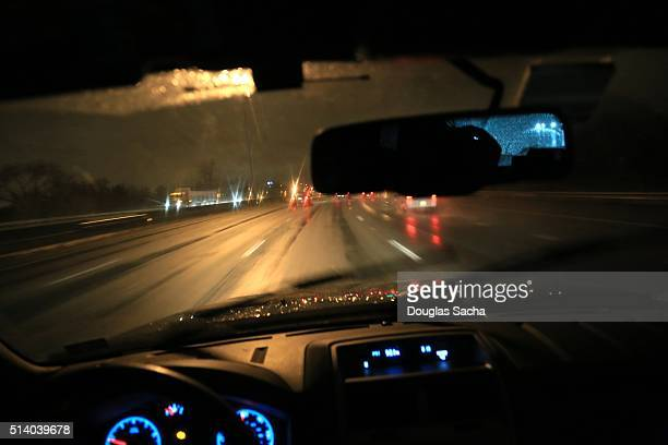 nighttime moving vehicle pov - dashboard camera point of view stock photos and pictures