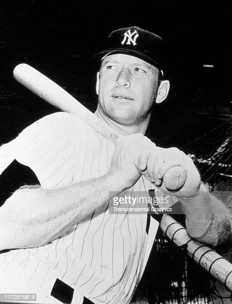 Nighttime portrait of American baseball player Mickey Mantle of the New York Yankees as he poses in a batting cage New York New York 1960