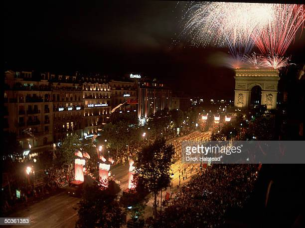 Nighttime revelers celebrating the Bicentennial of the French Revolution near the Arc de Triomphe