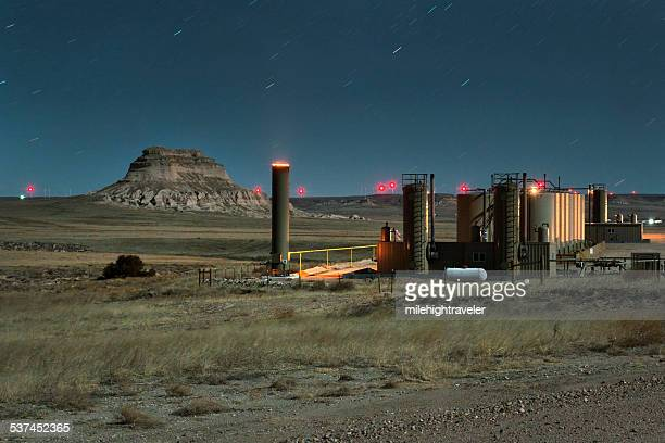 nighttime stars over petroleum production and pawnee buttes colorado - flare stack stock photos and pictures
