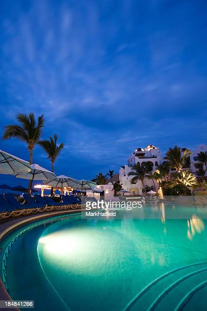 nighttime swimming pool and resort in cabo san lucas, mexico - cabo san lucas stock pictures, royalty-free photos & images
