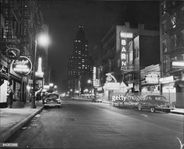 Nighttime view along 8th Street looking east from 6th Avenue New York New York 1950