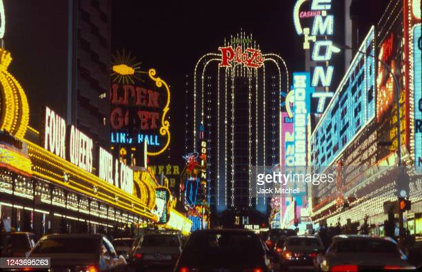 Nighttime view, looking east, of hotels and casinos on Fremont Street, Las Vegas, Nevada, February 1983. Visible business include the Golden Nugget,...