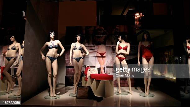 Nighttime view of an illuminated window display at the La Perla lingerie store 803 Madison Ave Manhattan's Upper East Side neighborhood New York New...