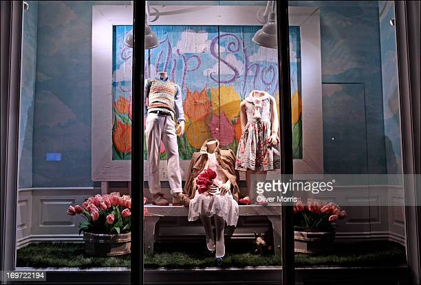 Nighttime view of an illuminated window display of children's summer fashions at the Ralph Lauren clothing store Manhattan's Upper East Side...
