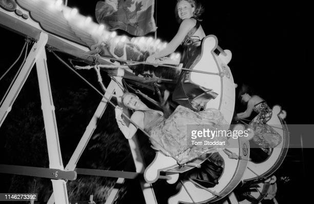 Nighttime view of Cambridge University students on a fairground ride after the annual May Ball Cambridge England June 2009 2009 marked the...