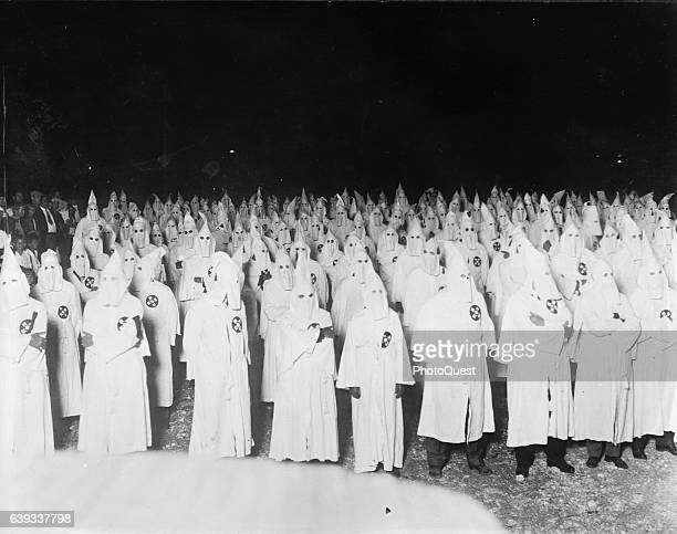 Nighttime view of hooded participants in a Ku Klux Klan rally Washington DC 1922