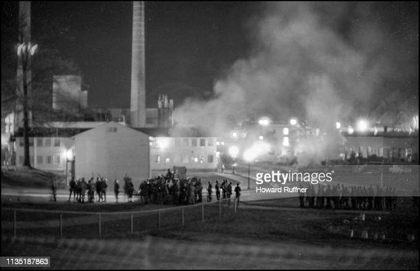 Nighttime view of Ohio National Guardsmen as they assemble on the Kent State University campus near the Reserve Officer Training Corps building as it...