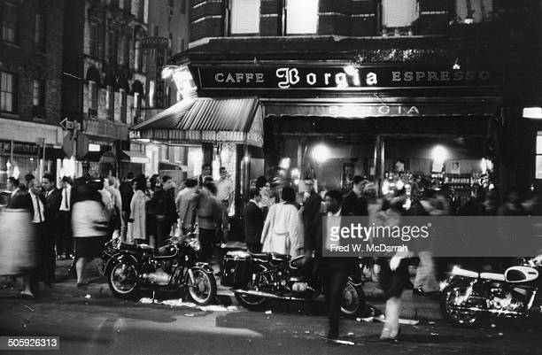 Nighttime view of pedestrians in front of Cafe Borgia at the intersection of MacDougal and Bleeker streets in Greenwich Village New York New York May...