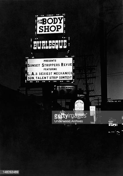 Nighttime view of the Body Shop marquee on Sunset Blvd Los Angeles California circa 1968 in West Hollywood featuring the Sunset Strippers Revue