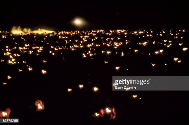 Nighttime view of the fires that dot the festival grounds during the Woodstock Music and Arts Fair in Bethel New York August 15 17 1969
