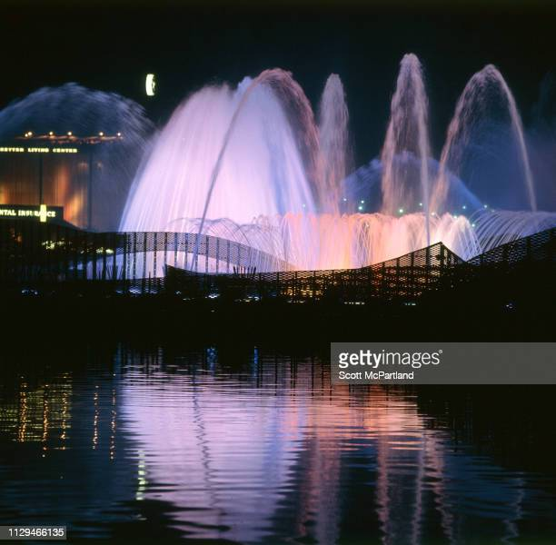 Nighttime view of the illuminated Fountain of the Planets during the World's Fair in Queens New York New York June 1965 Partially visible are Better...
