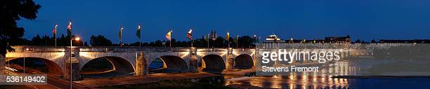 nighttime view of the woodrow wilson bridge and the loire river in tours - woodrow wilson bridge stock pictures, royalty-free photos & images