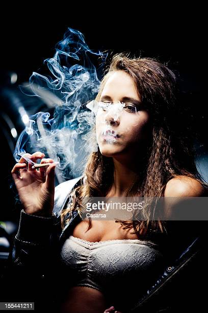 nighttime woman portrait - smoking weed stock photos and pictures