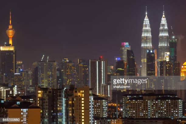 nightview of downtown kuala lumpur - shaifulzamri stock pictures, royalty-free photos & images