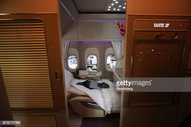 Nightwear and slippers lay on a bed in a first class private suite on board a Boeing Co777300ER passenger jetliner operated by Emirates Airline at...