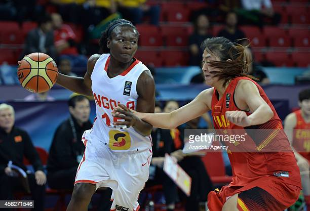 Nigiendula Filipe of Angola in action against her opponent during the 2014 FIBA World Championship for Women Group D basketball match between Angola...