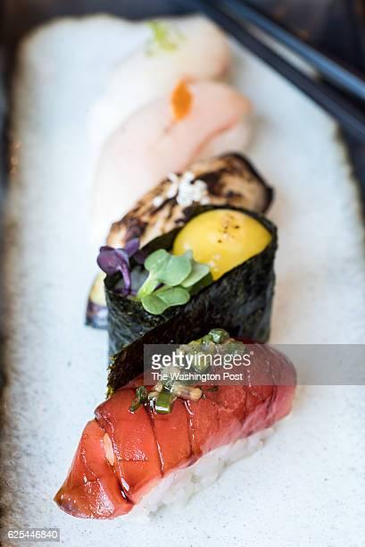 Nigiri Akami big eye tuna with tare and scallionginger Uzura quail egg with salt and pepper and micro mustard Nasu eggplant with yuzu miso and sesame...