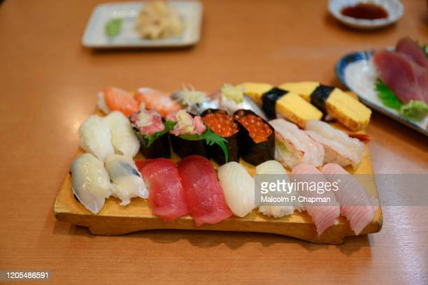 nigiri and maki sushi platter with tuna, salmon roe, prawn, squid served in restaurant in uneo, tokyo, japan - maki sushi stock pictures, royalty-free photos & images